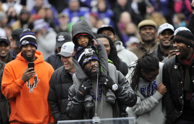 "Ed Reed, safety, draws laughs from his teammates and coach as he sings the chorus of ""Two Tickets to Paradise"" as the crowd joins in."