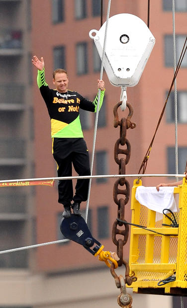 Tightrope walker Nik Wallenda celebrates his successful walk over the Inner Harbor, approx. 100 yards from the Light Street Pavilion to a barge by the Constellation, to mark the opening of the new Ripley's Museum.