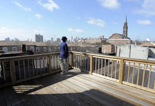 Jamila Ward enjoys the view from the home's third-floor outdoor deck.
