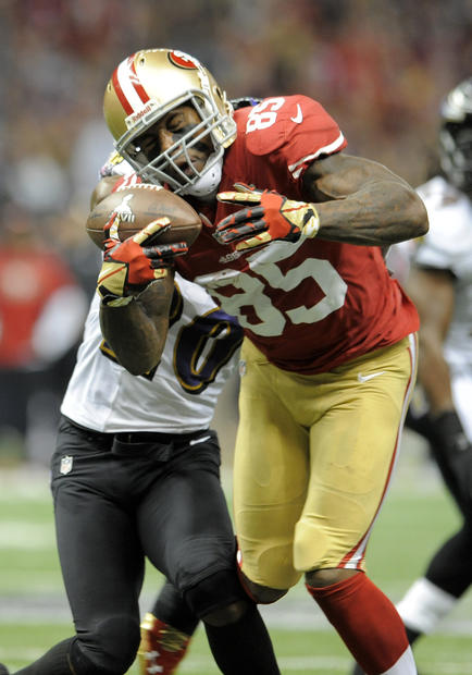 49ers tight end Vernon Davis is hit by Ed Reed after a first-quarter reception.