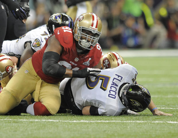 Joe Flacco is sacked by 49ers defender Ray McDonald in the first quarter.