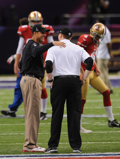 49ers coach Jim Harbaugh chats with his son, Jay, a Ravens coaching intern.