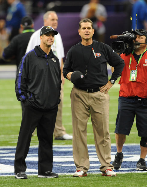 Ravens coach John Harbaugh and 49ers coach Jim Harbaugh stand together before kickoff.
