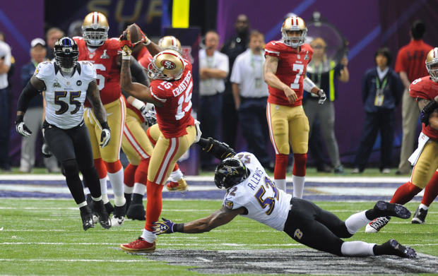 Ray Lewis dives to make a tackle on 49ers receiver Michael Crabtree.