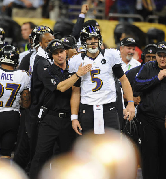 John Harbaugh congratulates Joe Flacco after a Ravens touchdown.