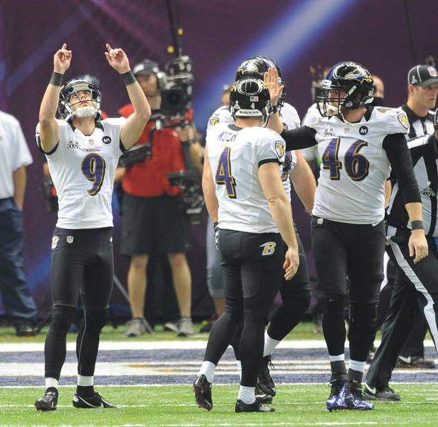 Justin Tucker celebrates a fourth-quarter field goal.