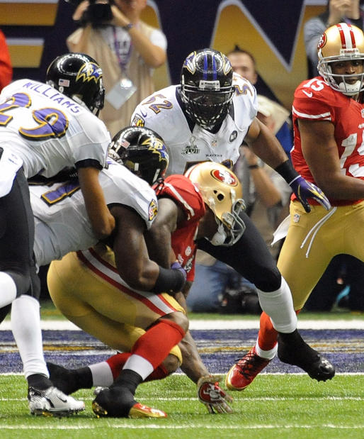 Ray Lewis watches as Courtney Upshaw tackles 49ers tight end Vernon Davis.