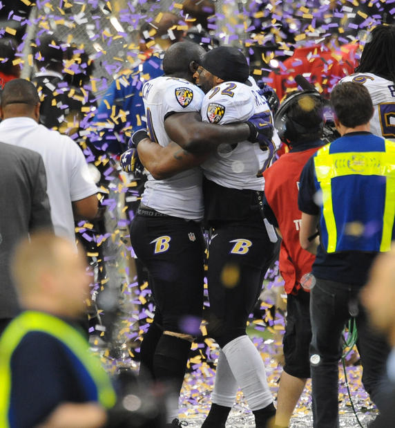 Ray Lewis hugs Vonta Leach after the Ravens won the Super Bowl.