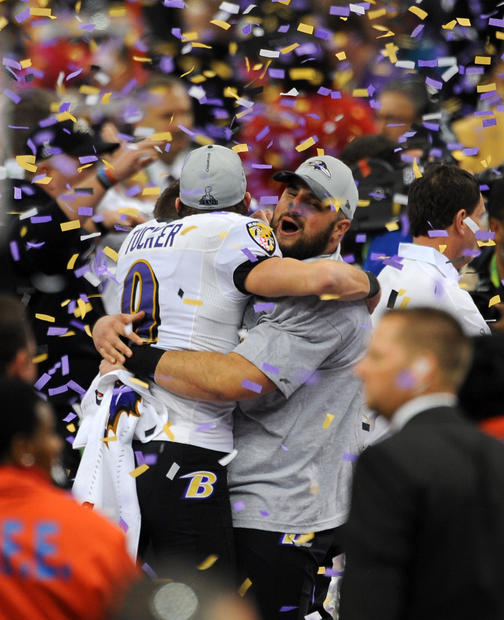 Justin Tucker is picked up by offensive lineman Gino Gradkowski after the Ravens won the Super Bowl.