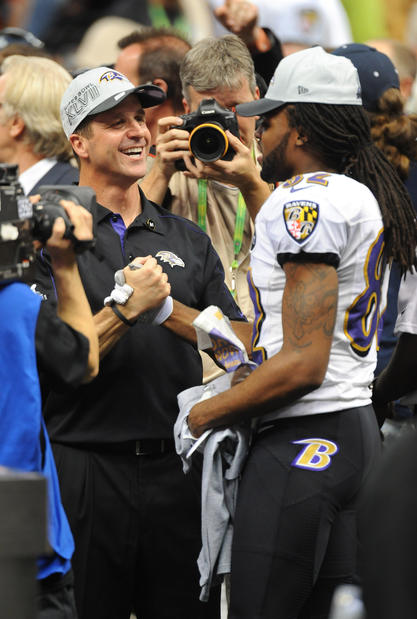 John Harbaugh celebrates the Ravens' Super Bowl win with Torrey Smith.