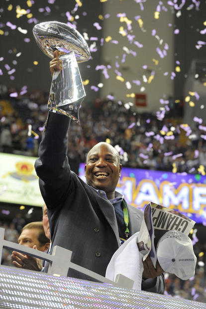 Ozzie Newsome holds up the Lombardi Trophy after the Ravens won the Super Bowl.