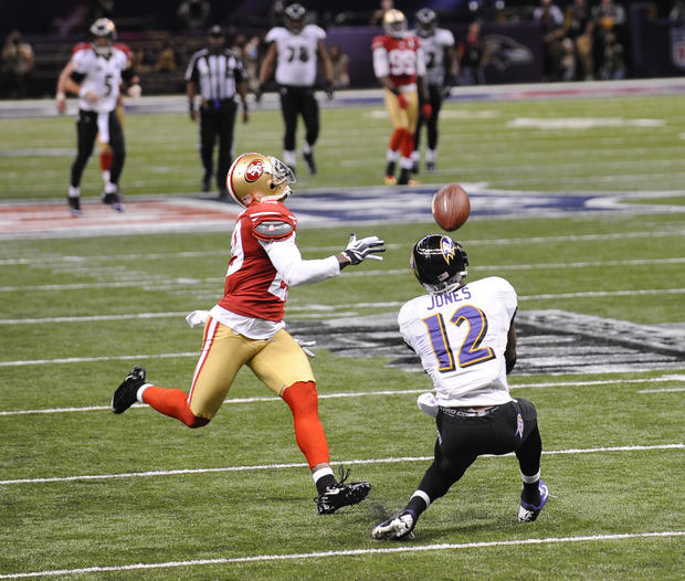 Jacoby Jones catches a pass behind 49ers cornerback Chris Culliver and runs into the end zone for a touchdown.