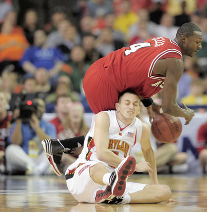North Carolina State's Courtney Fells (top) collides with Terps guard Eric Hayes during the first half in the opening round game at the ACC tournament in Atlanta.