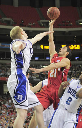 Terps guard Greivis Vasquez (right) shoots over Duke's Kyle Singler during the first half of the ACC semifinals at the Georgia Dome in Atlanta.