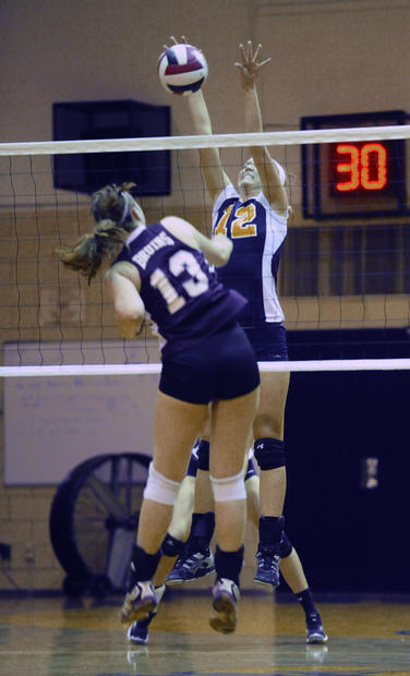 Severna Park's Cara Stine (No. 12) blocks a spike by Broadneck's Kathleen Wise in the first game.