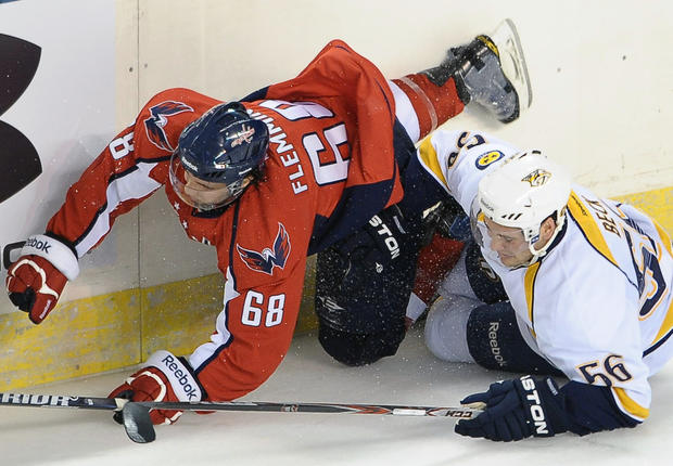 The Capitals' Brett Flemming, left, and the Predators' Taylor Beck crash into the boards during the inaugural Baltimore Hockey Classic at 1st Mariner Arena. Nashville beat Washington, 2-0, in the exhibition.