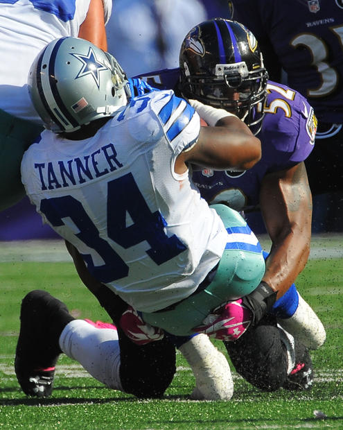 Ray Lewis tackles Dallas' Phillip Tanner in the third quarter.