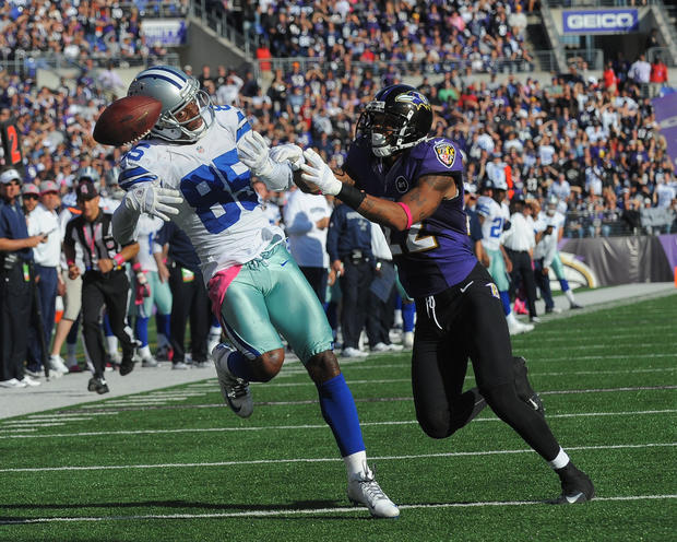 Dallas' Kevin Ogletree can't hold on to a pass from Tony Romo, as Jimmy Smith defends.