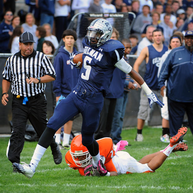 Gilman's Kai Locksley, top, breaks free from McDonogh's Eric Burrell to score a touchdown in the fourth quarter.