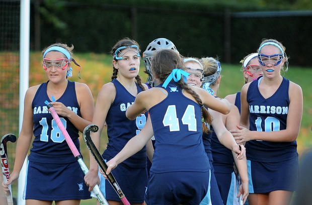 The Garrison Forest girls field hockey team celebrates a 4-1 win over Bryn Mawr.