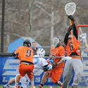 Princeton goalie Tyler Fiorito (6) saves a shot by Hopkins' Chris Boland