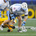 UMBC's Brian Patton, Hopkins' Mike Poppleton in the 2012 Face-Off Classic