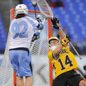 John Hopkins' Brandon Benn, UMBC goalie Adam Cohen
