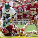 Denver's Chase Carraro, on ground, and Loyola's J.P. Dalton