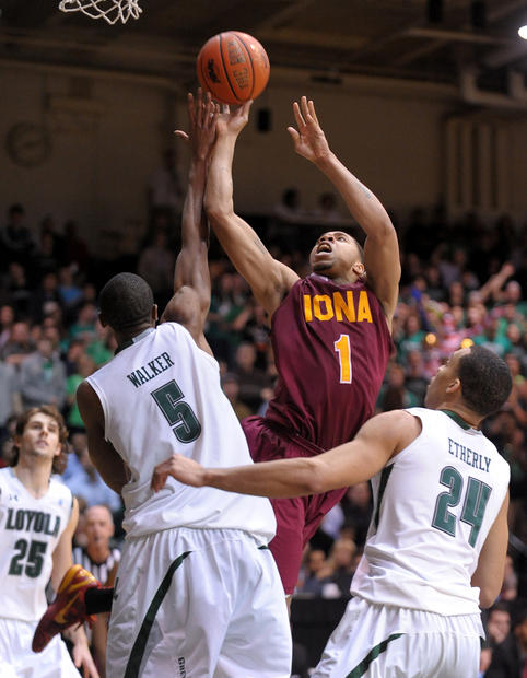 Iona's  Mike Glover led the way back for Iona in the second half, scoring two on this second half shot over Shane Walker and Erik Etherly.