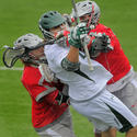 Loyola midfielder Josh Hawkins (in white) Ohio State midfielder Shawn Kaplan (left) and attackman Logan Schuss