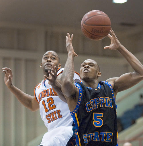 Morgan State Bears forward Aric Brooks (12) battles Coppin State Eagles guard Michael Harper (5) in the paint for a rebound in the first half of their cross-town rivalry at Hill Field House. The Bears clawed the Eagles, 70-64.