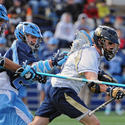 North Carolina's Mark Staines (left) and Thomas Wood, Navy's Bryce Dabbs
