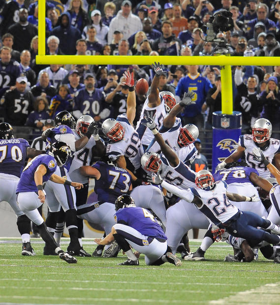 Justin Tucker kicks the game-winning field goal against the Patriots.