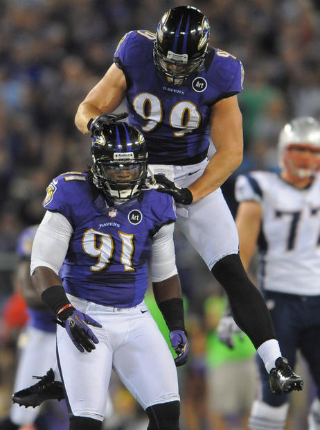 Paul Kruger celebrates with Courtney Upshaw after they teamed up to drop New England's Julian Edelman for a 15-yard loss.