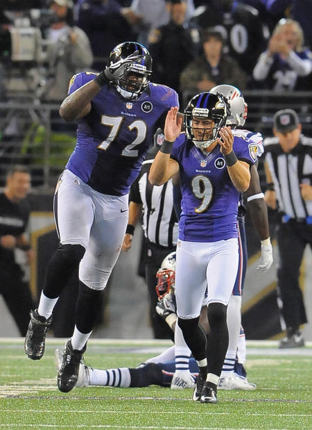 Kelechi Osemele leaps in celebration as Justin Tucker claps his hands after connecting on the game-winning field goal.