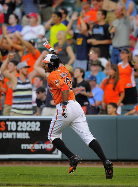 The Orioles' Adam Jones rounds the bases after his game-winning two-run homer against the Phillies.