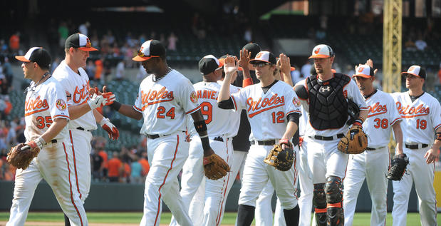 The Orioles congratulate each other after beating the Athletics, 6-1, Sunday at Camden Yards.