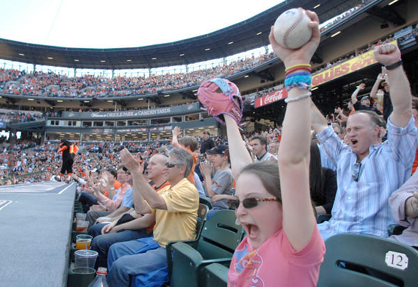 Shelby Snyder cheers a Nick Markakis double in the 5th inning of opening day at Camden Yards.