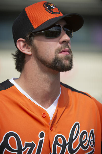 Michael Phelps took batting practice at Orioles spring training.