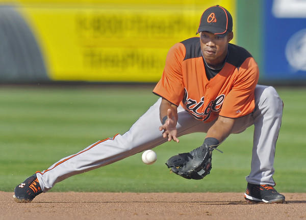 Orioles shortstop Pedro Florimon Jr. moves to field a grounder against the Philadelphia Phillies. Visiting Baltimore survived a late scare by the host Phillies, 6-5.
