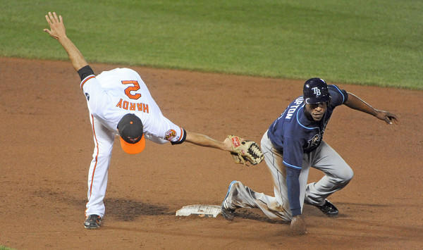 Orioles shortstop J.J. Hardy, left, can't tag the Rays' B.J. Upton on a stolen base in the eighth inning.