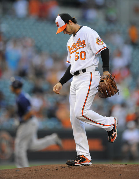 Orioles starting pitcher Miguel Gonzalez walks around the mound after giving up a solo home run to the Tampa Bay Rays' Desmond Jennings on the first pitch of the game at Camden Yards.