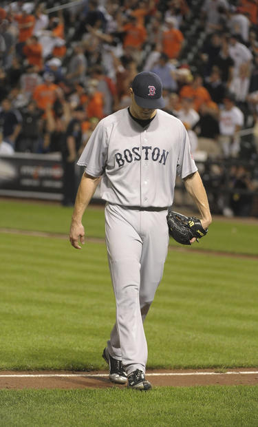 Red Sox closer Jonathan Papelbon walks off the field after giving up the winning hit by the Orioles' Robert Andino.