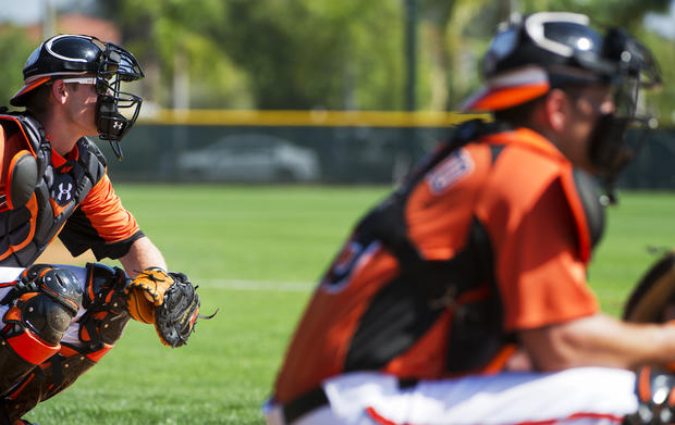 Orioles catchers Matt Wieters and Luis Exposito catch bullpen side sessions.