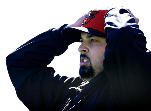 Daniel Schlereth adjusts his hat during spring training.