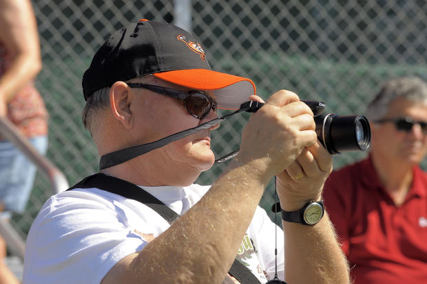 Orioles fan Paul Synor of Buffalo takes pictures of the O's during spring training.