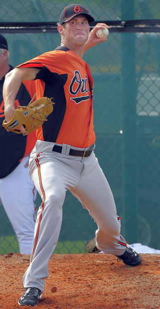 Orioles lefty Brian Matusz pitches during a throwing session.