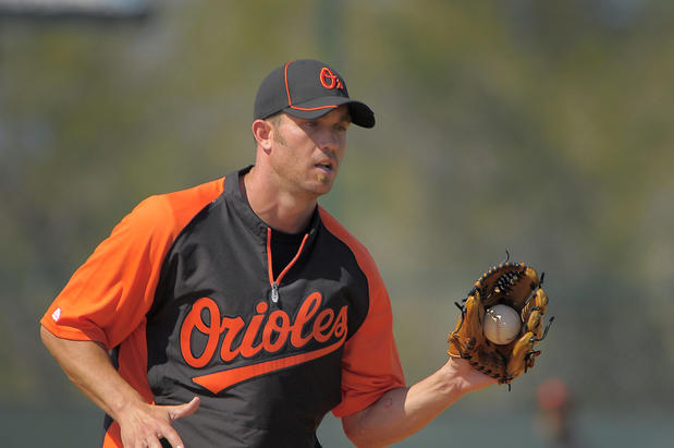 Orioles shortstop J.J. Hardy takes part in defensive drills.