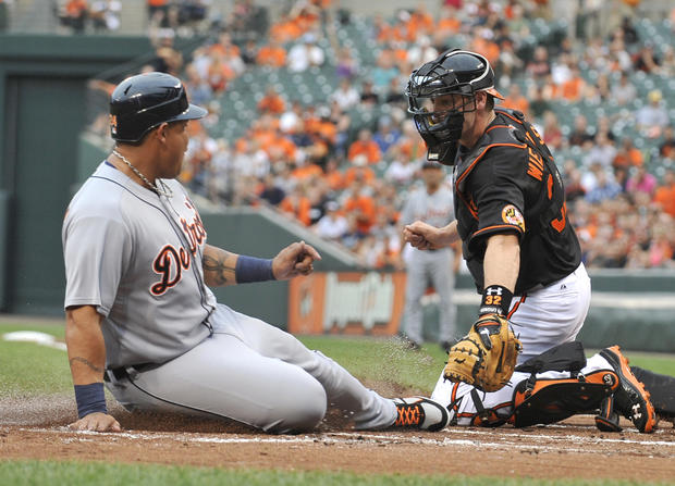Orioles catcher Matt Wieters makes a late tag on Detroit's Miguel Cabrera as Carbrera scores in the top of the first inning on a hit by Brennan Boesch.