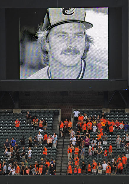 A photo of Mike Flanagan, who died a year ago, is displayed on the screen before Friday's game between the Orioles and Blue Jays.